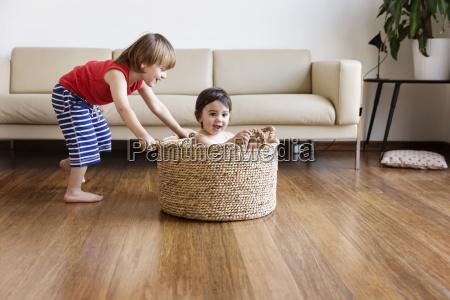 toddler girl sitting in a basket
