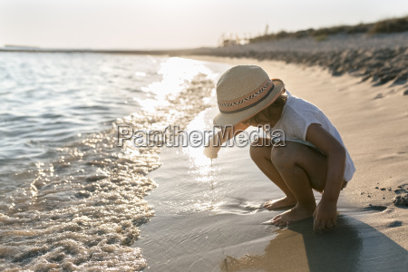 spain menorca little girl playing on