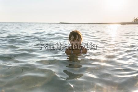spain menorca girl swimming in the