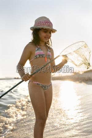 spain menorca girl with a dip