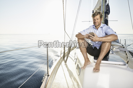 smiling mature man sitting on his