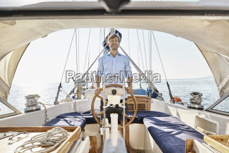 mature man at helm of his