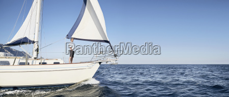 mature man standing on his sailing