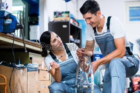 woman and man as bike mechanics