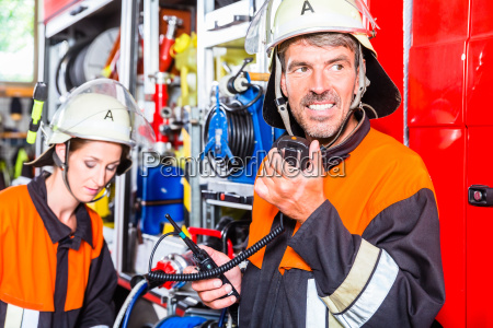 chief fire fighter checking radio