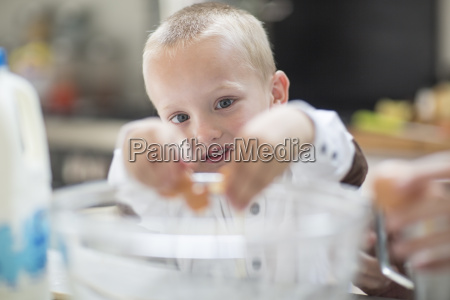 boy helping to cook in kitchen