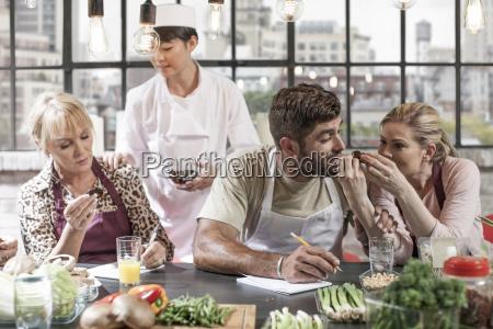 female chef handing over food samples