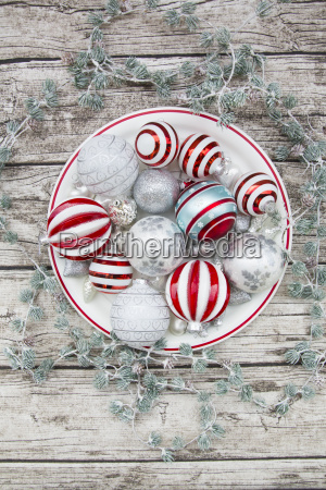 christmas baubles on plate