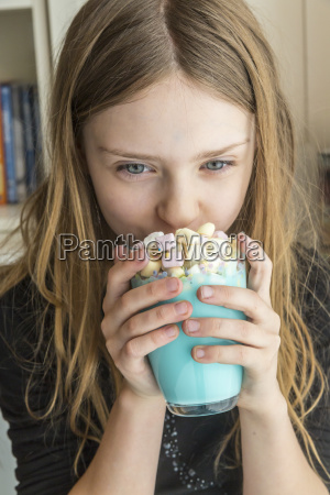 girl drinking glass of unicorn milk