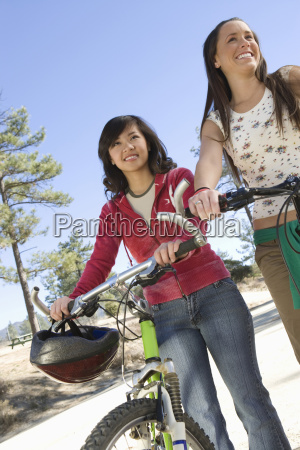 female friends with mountain bikes