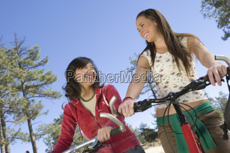 happy female friends with mountain bikes