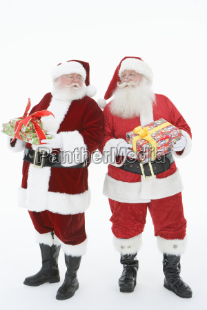 men in santa claus outfits holding
