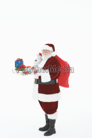santa claus standing with bag and