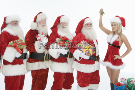 men dressed in santa claus outfits