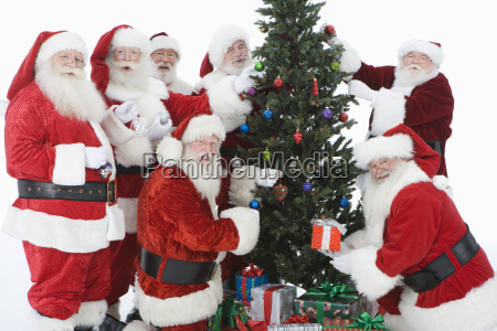 santa claus with christmas tree and