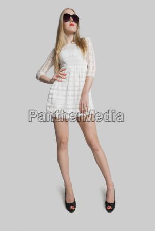 full length stylish teenage girl posing