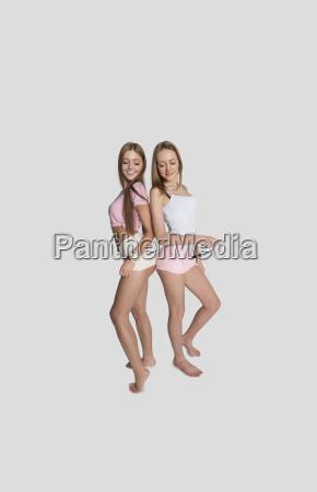 full length of female friends wearing