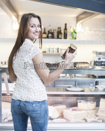rear view of smiling woman holding