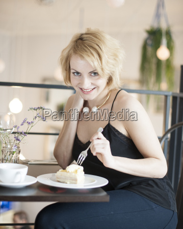 portrait of happy young woman eating