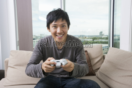 excited mid adult man playing video