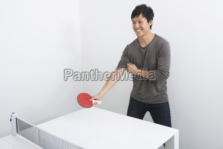 handsome mid adult man playing table