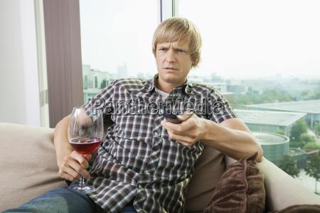 displeased mid adult man with wine