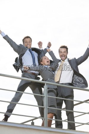 low angle view of excited businesspeople