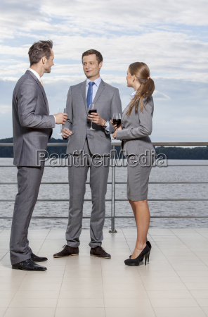 full length of young businesspeople holding