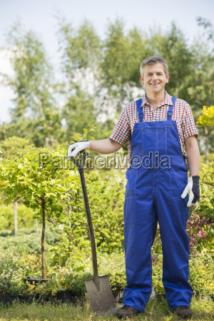 full length portrait of confident gardener