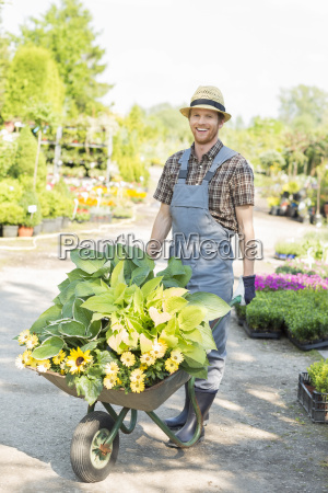 full length portrait of happy gardener