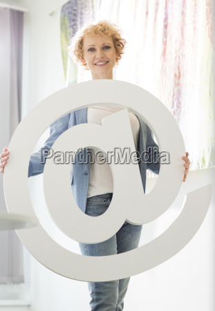 portrait of confident businesswoman holding at