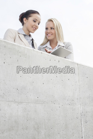 low angle view of smiling business