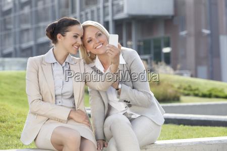 happy young businesswomen taking self portrait
