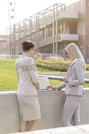 young businesswomen working together on laptop