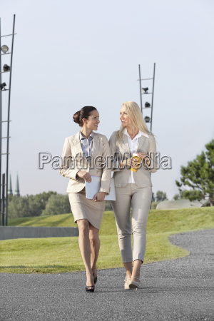 full length of happy young businesswomen