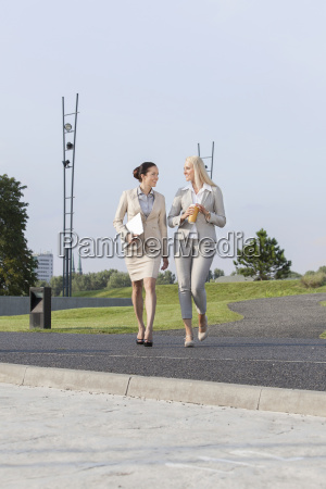 full length of young businesswomen walking