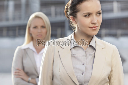 young businesswoman looking away with female
