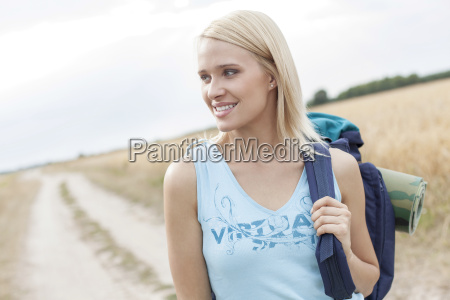 beautiful female hiker with backpack looking