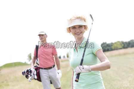 portrait of happy female golfer with