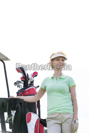low angle view of smiling golfer