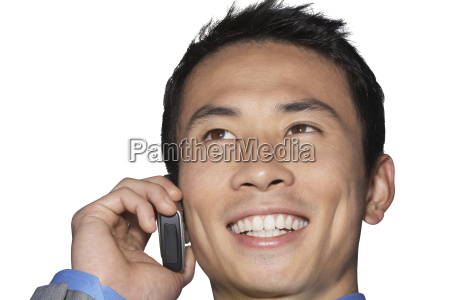 cheerful mid adult businessman using cell