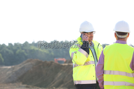 supervisor using mobile phone while standing