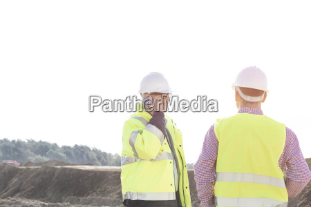 male engineer using mobile phone while