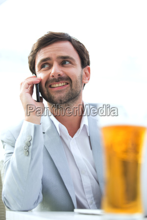 happy businessman looking away while using