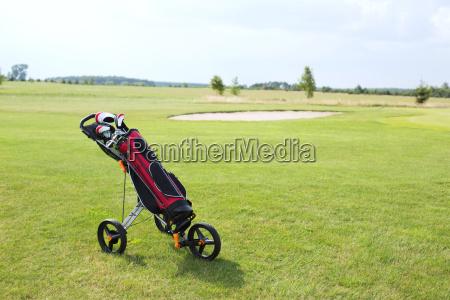 golf club bag on pushcart at