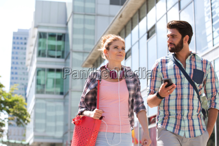 male and female friends walking outside