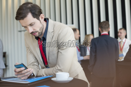 businessman using smart phone while coffee