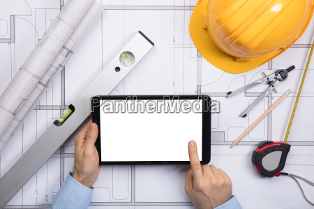 an architect touching the screen of