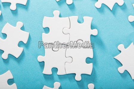 white jigsaw puzzles on blue background