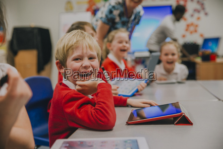 happy student in technology lesson